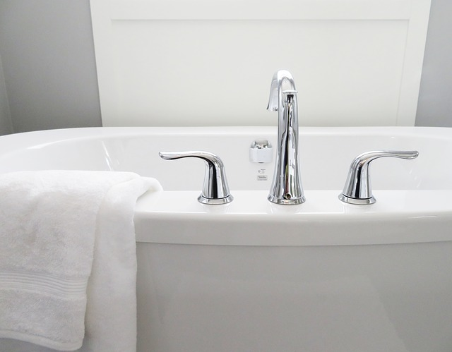bathtub and chrome tap ware