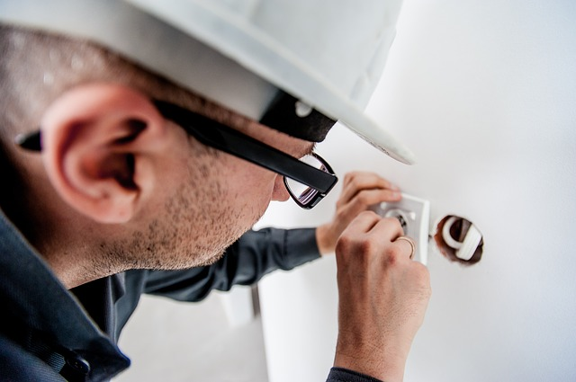 electrician adjusting powerpoint