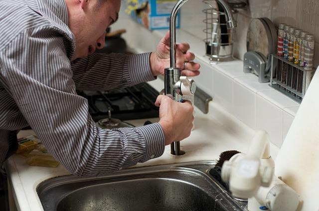 plumber adjusting tap