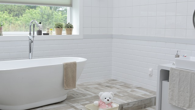 modern white ensuite bathroom with tub and teddy bear